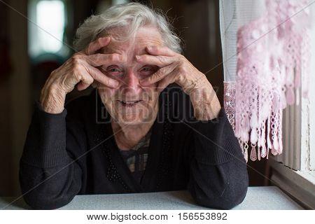 Portrait of funny elderly woman.