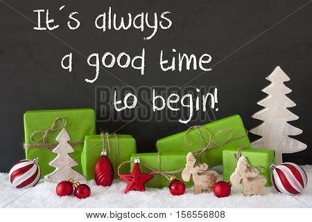 English Text Quote It Is Always A Good Time To Begin. Green Gifts Or Presents With Christmas Decoration Like Tree, Moose Or Red Christmas Tree Ball. Black Cement Wall As Background With Snow.