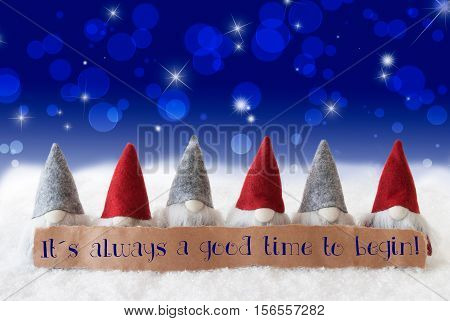 Label With English Quote It Is Always A Good Time To Begin. Christmas Greeting Card With Gnomes. Sparkling Bokeh And Blue Background With Snow And Stars.