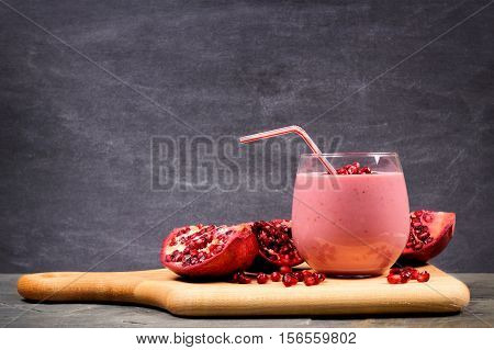 Pomegranate Raspberry Smoothie On A Paddle Board With Pomegranate Pieces, Scene On Black Slate