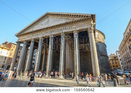 Rome Italy - August 22 2015: backside of the famous ancient church Pantheon in Rome Italy people walking in the square