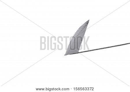 Still Life of a Knife Blade Cutting Through Surface
