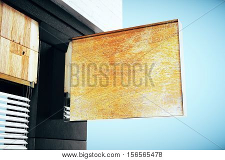 Blank wooden stopper on dark building exterior and blue background. Mock up 3D Rendering