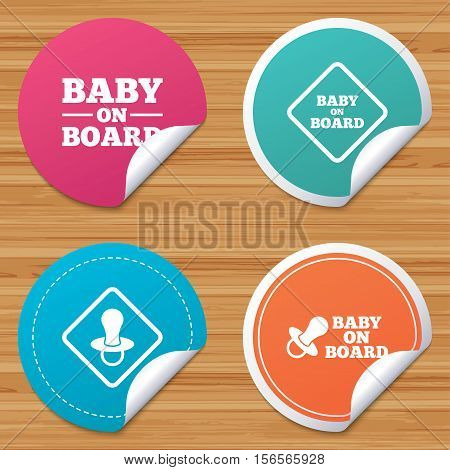 Round stickers or website banners. Baby on board icons. Infant caution signs. Nipple pacifier symbol. Circle badges with bended corner. Vector