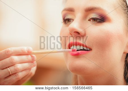Make Up Artist Applying Lipstick With Brush.