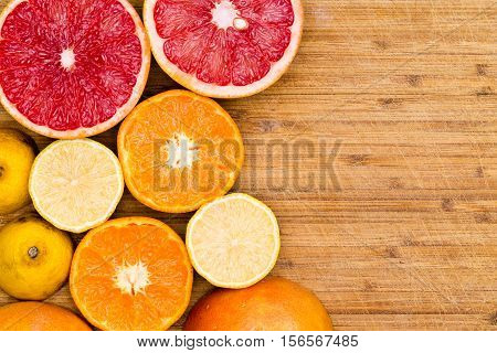 Sliced Grapefruit, Oranges And Lemons On Wood