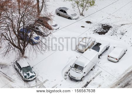 Cars in the parking lot after snowstorm view from above