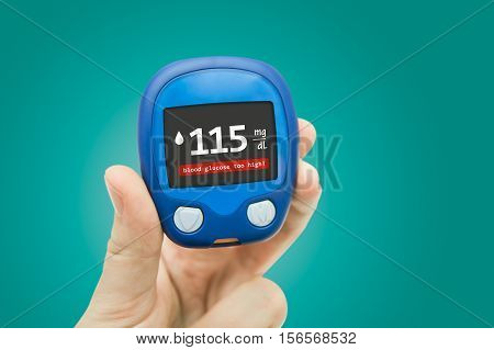 Hand holding meter. Diabetes doing glucose level test. Medical background concept