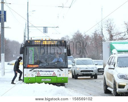 Moscow, Russia - November, 12, 2016: Bus on a bus stop after a snowstorm in Moscow, Russia
