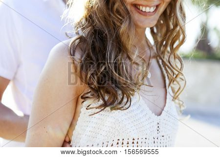 a close up of a young woman with curly hair