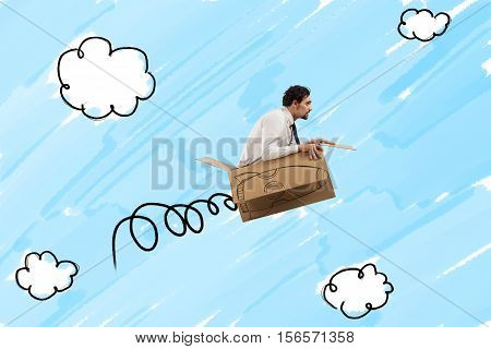 Businessman flying with a cardboard missile with fire in the sky