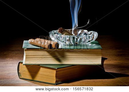 Blue Smoke From Cigar With Ashtray And Two Books Volume