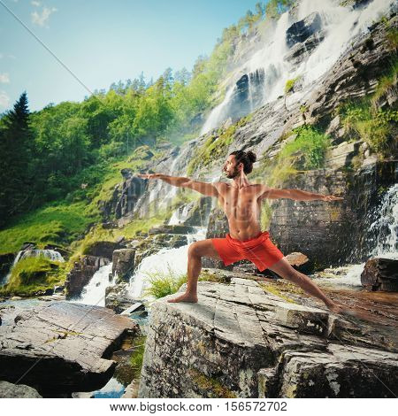 Yoga in a natural landscape with waterfall