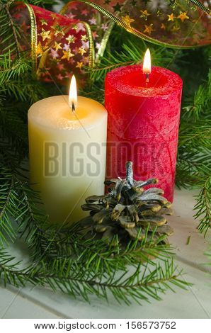 New Year and Christmas background with candles decorated Christmas tree in red