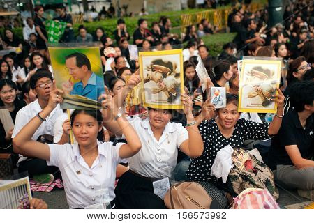BANGKOK ,THAILAND -OCTOBER 20, 2016 : The ceremony to commemorate King Bhumibol Adulyadej. People have raised the image of a king over her head. Vintage style picture at Sanam Luang ,Bangkok,Thailand.