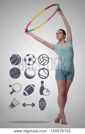 Woman with hula loop in sport concept