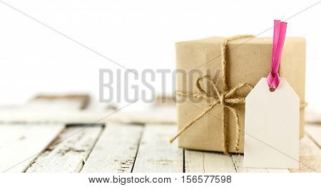 Brown Gift Box With Blank Card On White