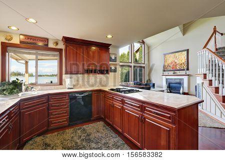 Mahogany Kitchen Cabinets, Marble Counter Tops And Backsplash