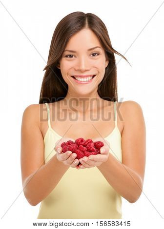 Woman holding fresh raspberries in hands closeup isolated on white background. Portrait of Asian woman showing handful of red raspberries in woman hands. Raspberry fruit berry concept.