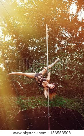 Female pole dancer in park