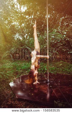 Female pole dancer in park