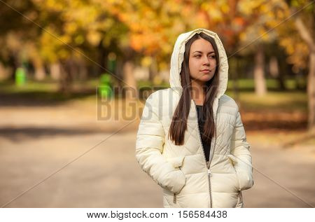 portrait of a sad girl in the autumn park