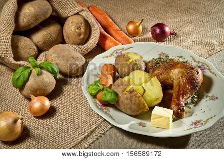 Roasted Chicken Leg Serve With Jacket Potatoes And Vegetables