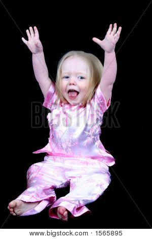 Cute Little Girl With Her Hands In The Air