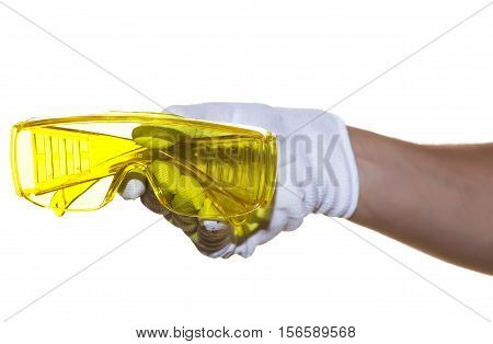 Yellow Safety Glasses In Hand