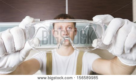 Worker Trying On Safety Glasses