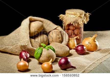 Burlap Sack With Vegetables And Maraschino Cherries Jar