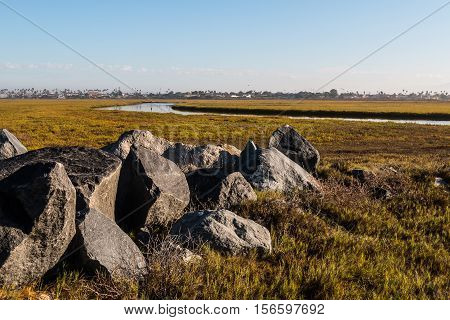 Boulders on the Tijuana River National Estuarine Research Reserve in the morning light in San Diego, California.