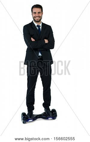 Portrait of businessman on hoverboard on white background