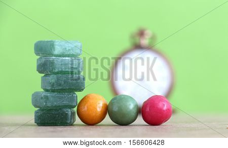 picture of a Green mints candy and bubble gum on green background.