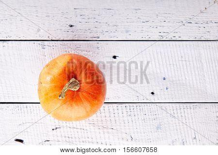Pumpkin on Wooden Background Top View