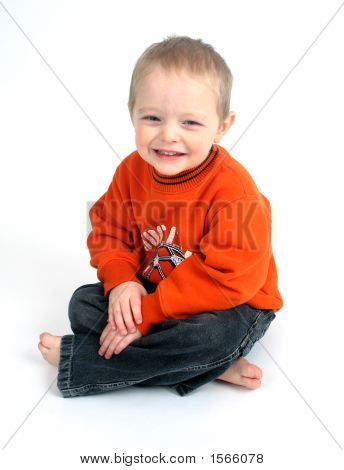 Cute Little Boy Smiling On A White Background