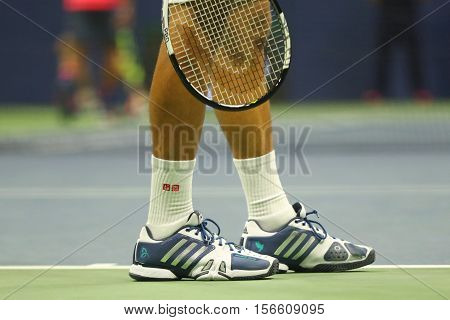 NEW YORK - SEPTEMBER 6, 2016: Grand Slam champion Novak Djokovic of Serbia wears custom Adidas tennis shoes during match at US Open 2016 at Billie Jean King National Tennis Center in New York