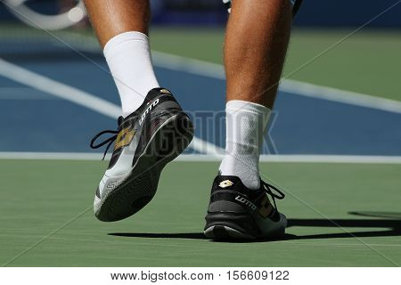 NEW YORK - AUGUST 29, 2016: Professional tennis player Denis Istomin of Uzbekistan wears custom Lotto tennis shoes during match at US Open 2016 at Billie Jean King National Tennis Center in New York