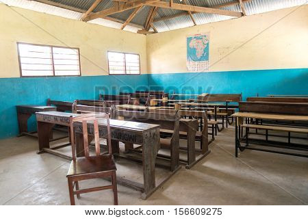 simple class room in village school with wooden desks and chairs in Zanzibar, Africa