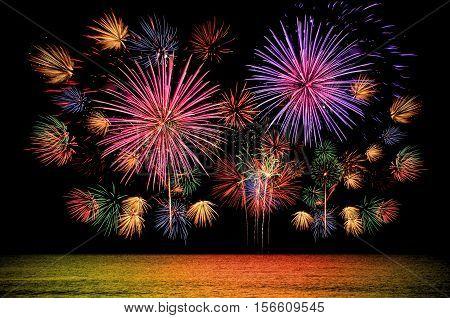 Colorful Firework Celebration On Dark Night Sky Background.