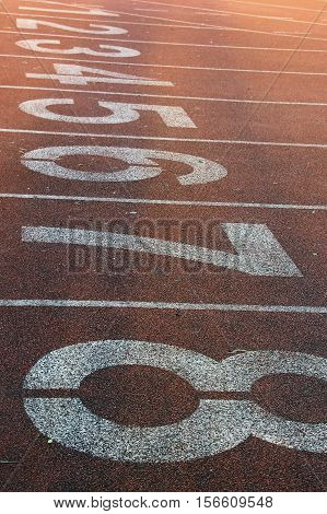 Red running track numbers in the stadium