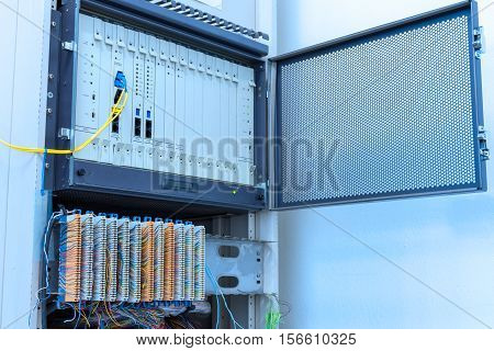 Private Automatic Branch eXchange (PABX) with extension line patch panel in rack cabinet telephone system.
