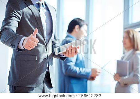 photo of businessman s thumb up at deal