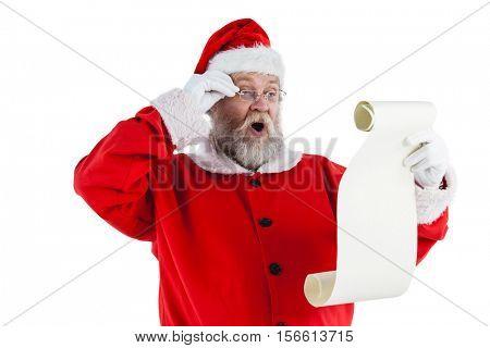 Santa claus making facial expression while reading scroll Santa claus making facial expression while reading scroll against white background