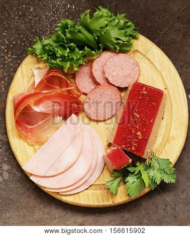 Assorted deli meats - ham, salami, parma, prosciutto, pate