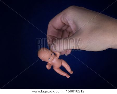 An embryo in a woman's hands. Concept of protection of life and abortion