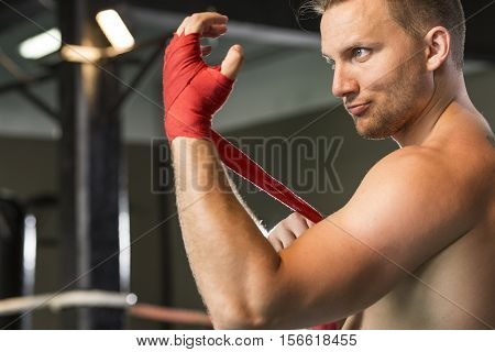 Boxer Wrapping His Hand