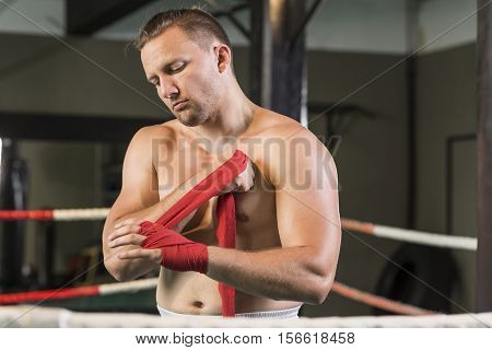 Boxer wrapping his hand before a fight