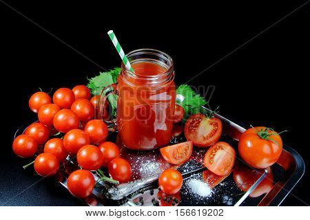 tomato juice with fresh tomatoes on a silver platter