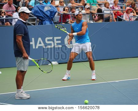 NEW YORK -SEPTEMBER 3, 2016: Fourteen times Grand Slam Champion Rafael Nadal of Spain with his coach Tony Nadal practices for US Open 2016 at Billie Jean King National Tennis Center in New York